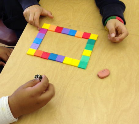 Students using tiles to find the perimeter of a rectangle