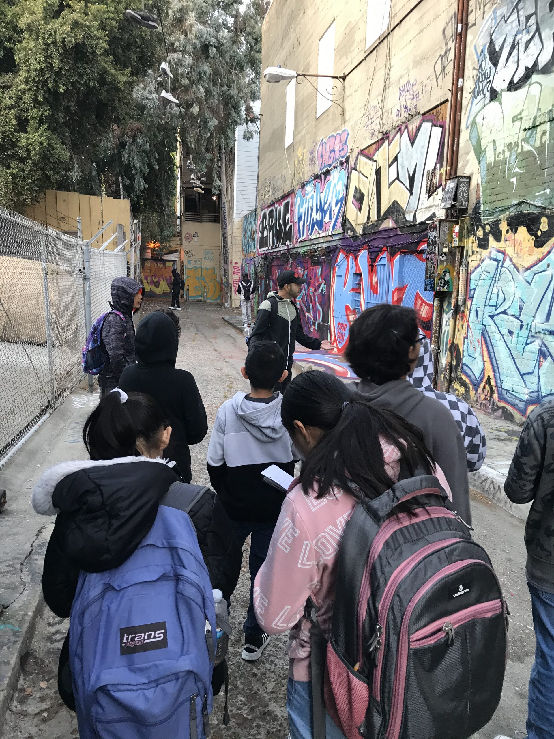 Students taking a community walk through the Mission District.