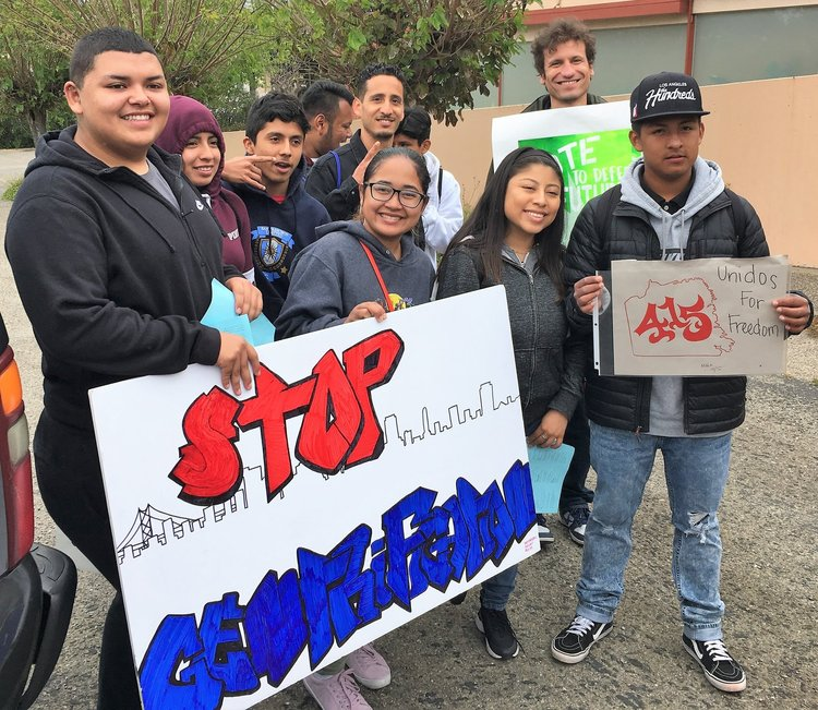 students and teachers at gentrification rally