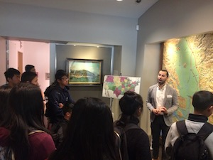 Students listening to a tour guide