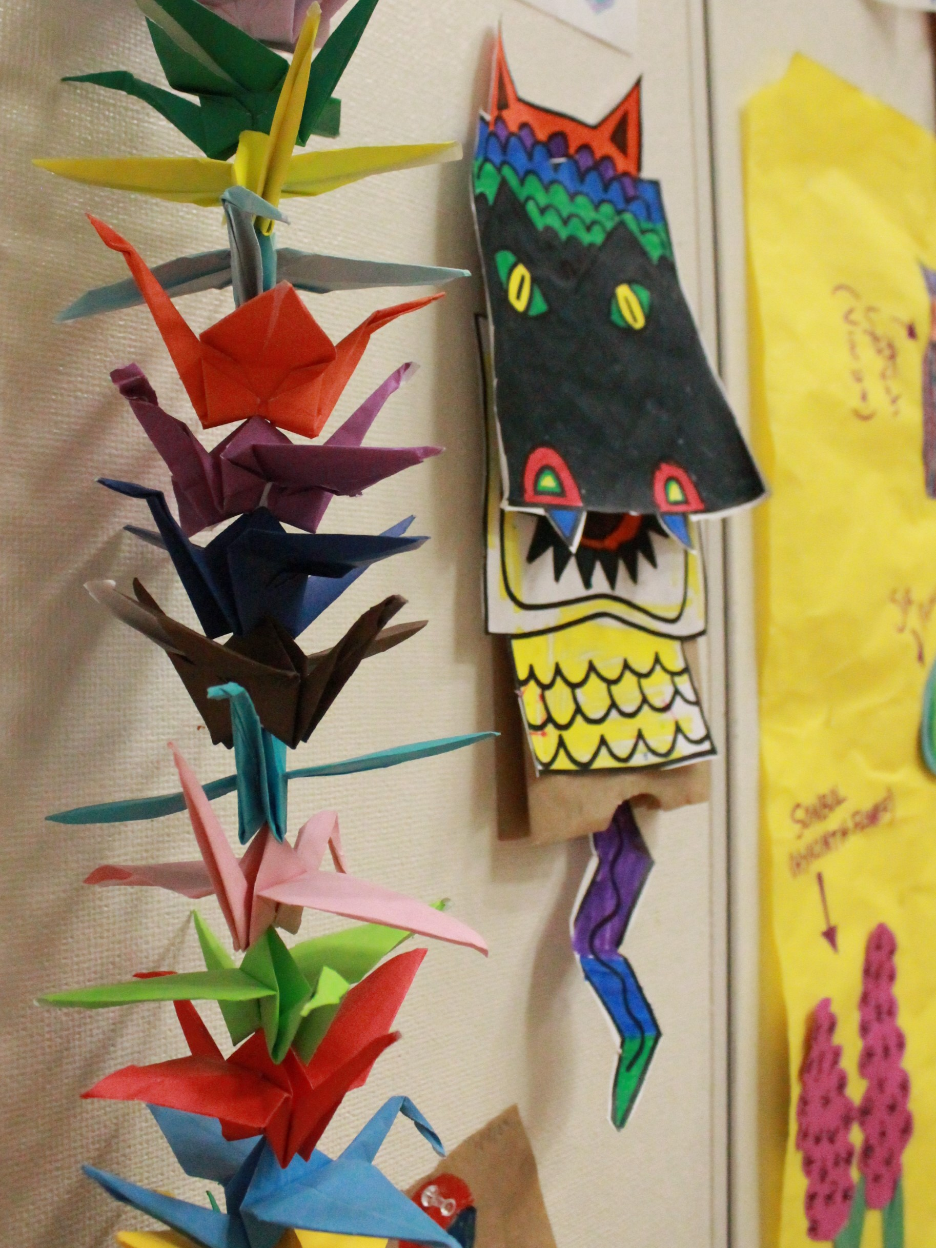 Colorful paper crafts hanging on a wall at an Asian Heritage festival