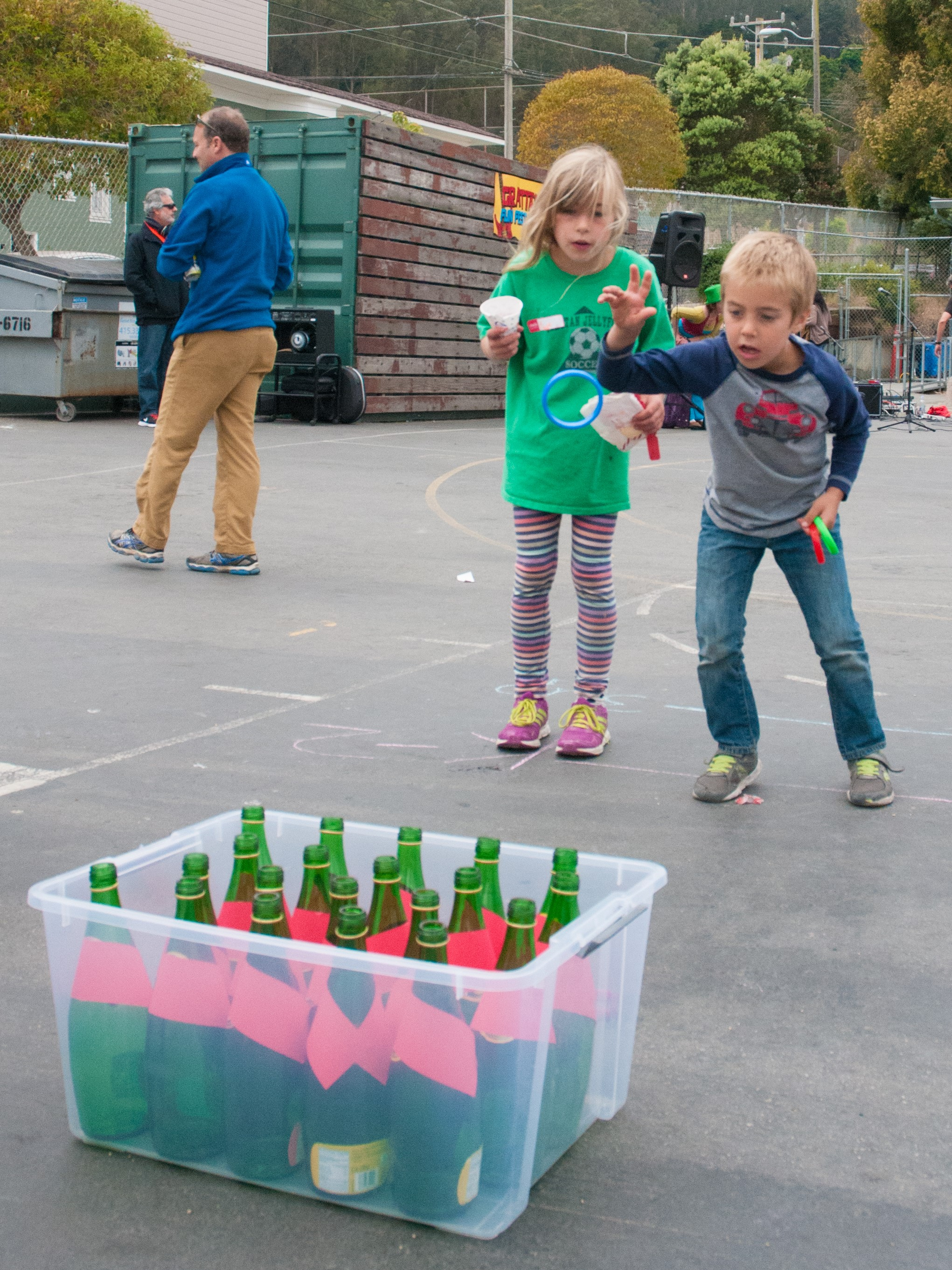 Children playing ring toss at an outdoor school festival