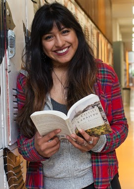 Smiling student with book