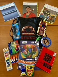 Art supply kit featuring SFUSD tote bag and curriculum materials