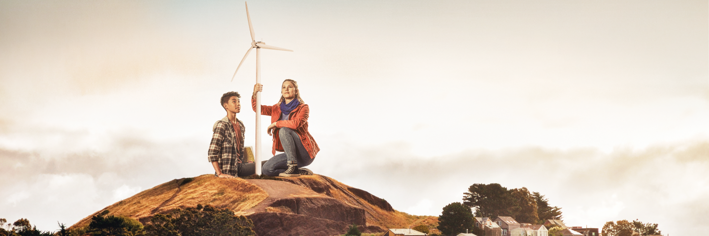 Two students by wind turbine