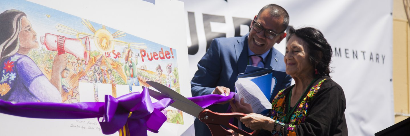 Dolores Huerta and Principal Luis Rodriguez cut the ribbon in the newly renamed Dolores Huerta Elementary School.