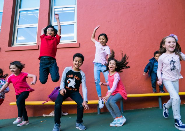 A row of elementary students jumping