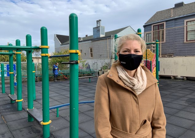 Cadi Poile, director of custodial services at SFUSD, stands wearing a face mask at an SFUSD school playground