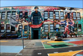 Exterior of César Chávez Elementary School with mural of César Chávez