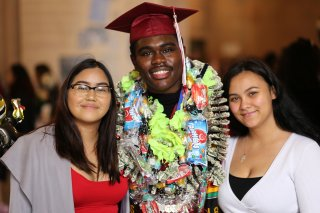 A graduating senior with two friends