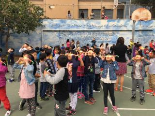 Gordon Lau students celebrating solar eclipse