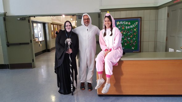 Three teachers dressed up for Halloween