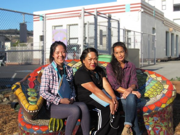 VVES 4th grade teachers are sitting on a mosaic lizard bench. From Left to Right: Katie Lin, Salavao Lopez, Evelyn Chan.