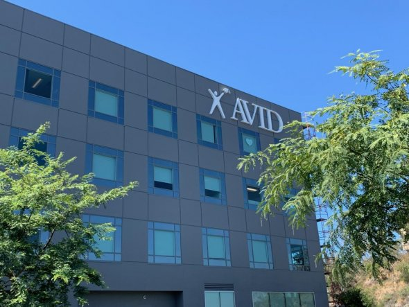 building with AVID on the side