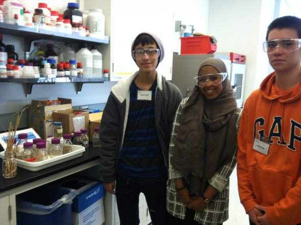 Three students visit a research lab.