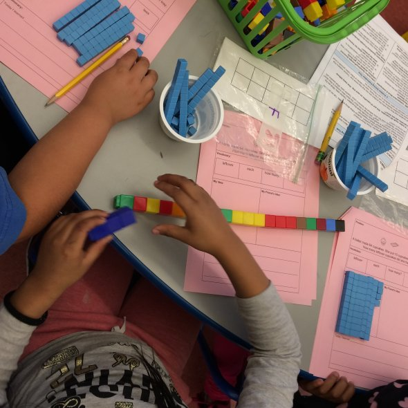 Students using cubes and base-10 blocks to model subtraction