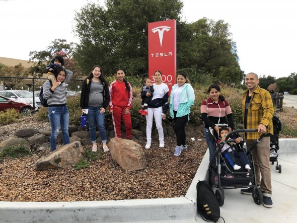 Young women from Hilltop High School pictured outside of the Tesla Headquarters.