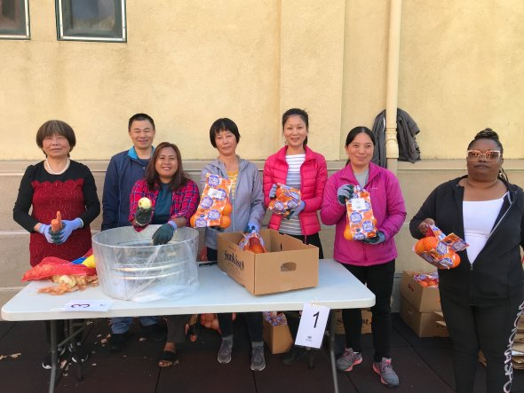 Group of adult women helping with food bank