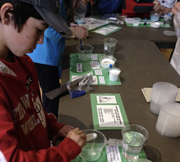 Students perform science experiments