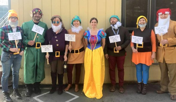 School staff dressed as Snow White and the Seven Dwarfs