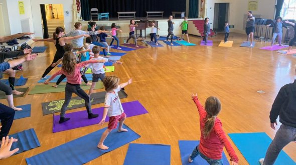 Students participating in yoga exercises