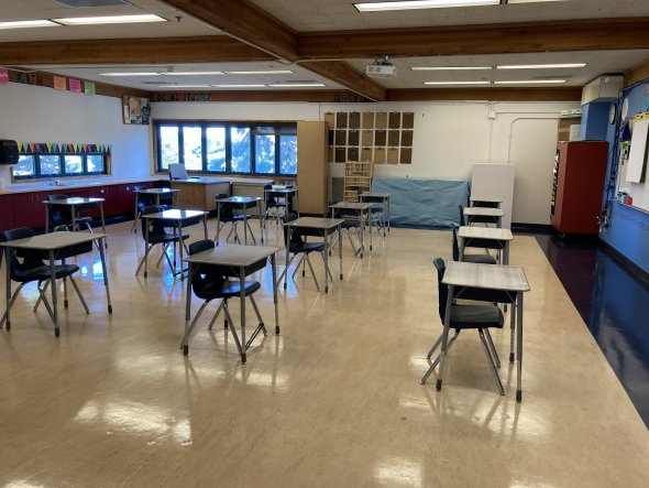 inside of classroom with desks spread out in room facing same direction