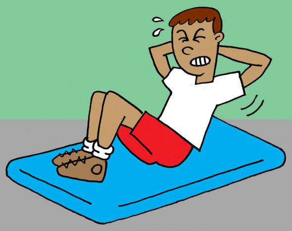 Boy doing sit-up on mat and sweating