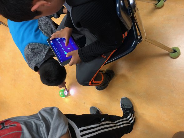 Students programming a robot.