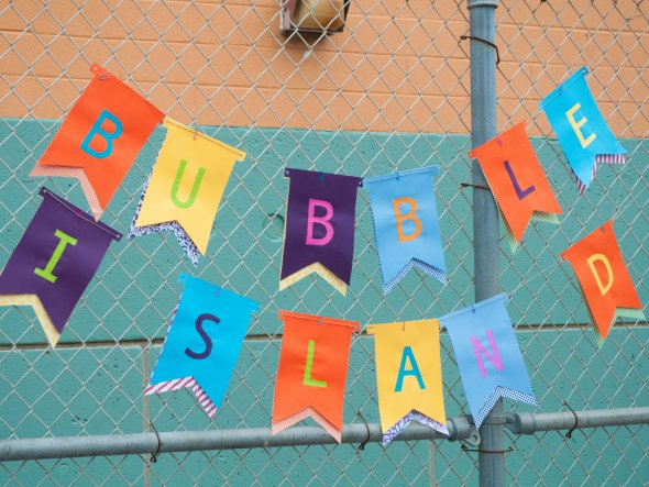 Colorful sign for Bubble Island at an outdoor school festival