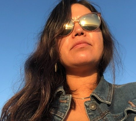 Latina woman with medium length hair and wearing sunglasses.