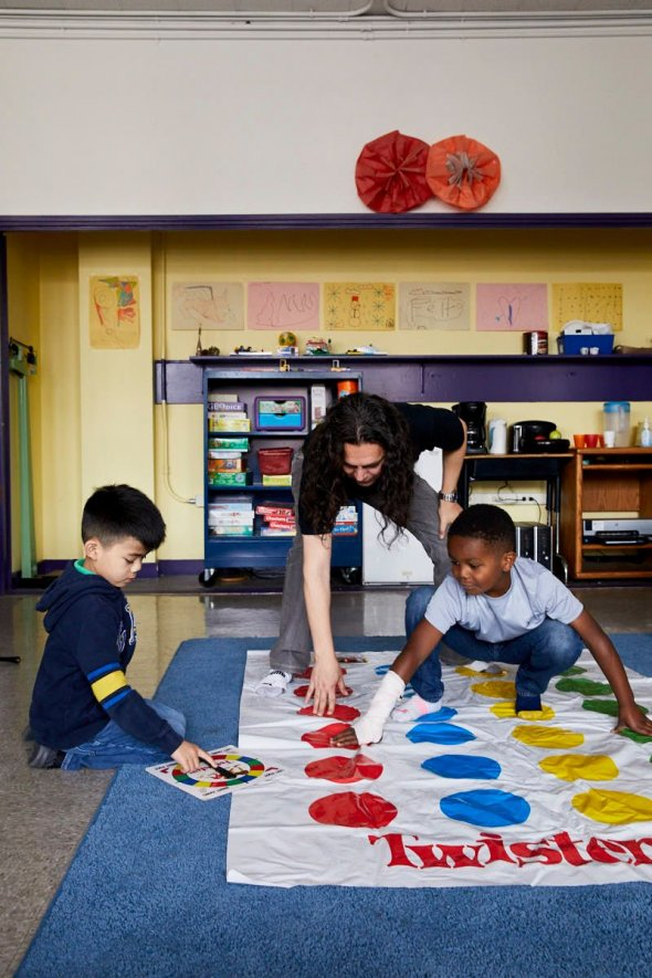 teacher and two students play twister