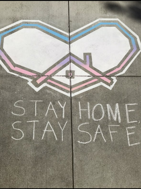 Stay Home Stay Safe sidewalk chark art with a heart