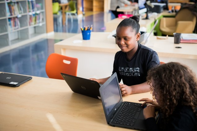 Two students on laptops