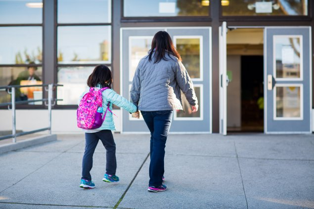 Student and parent walking to enter school